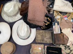 A fur stole together with hats, scarf, buttons, gloves, purses,