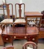 A 19th century mahogany sideboard with drawers and square tapering legs and spade feet,