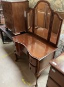 An Edwardian mahogany dressing table with tryptych mirror and five drawers on cabriole legs and pad
