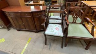 A reproduction mahogany sideboard together with two pairs of dining chairs
