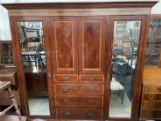 An Edwardian mahogany triple wardrobe,