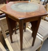 A brass inlaid mahogany table on six legs