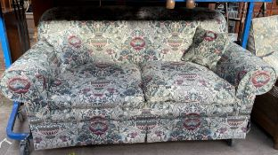A floral decorated upholstered two seater settee