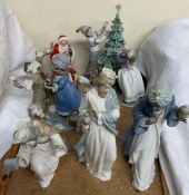 A Lladro figure group of children dressing a Christmas tree,