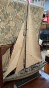 A model yacht with a canvas sail