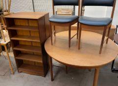 An A.H. McIntosh & Co, Kilcaldy, Scotland teak extending dining table