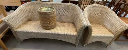 A wicker conservatory settee, armchair,