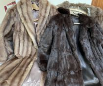 A dark brown three quarter length fur coat together with two other fur coats