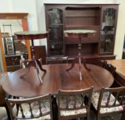 A reproduction mahogany dining suite including an extending dining table,