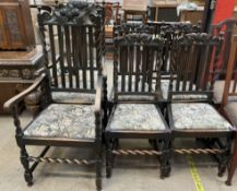 A set of six 17th century style oak dining chairs with carved backs and drop in seats on barley