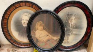 A pair of photographic portrait prints together with another