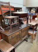 A 20th century oak mirrorback sideboard together with a piano stool,