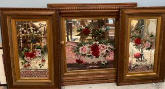A pair of late Victorian / Edwardian oak framed wall mirrors decorated with baskets of flowers