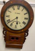 A Victorian walnut drop dial wall clock, the circular enamel dial with Roman numerals inscribed X.