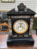 A Victorian black slate mantle clock, of architectural form,