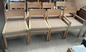 A set of eight oak dining chairs with squab seats on square legs