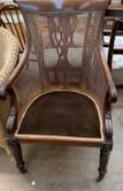 A William IV mahogany bergère library chair,