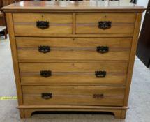 An Edwardian satin walnut chest,