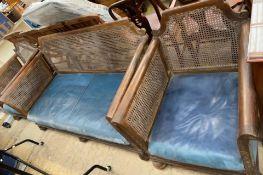 A walnut framed three piece bergere suite, double caned, settee 174cm wide x 84cm deep x 82cm high,