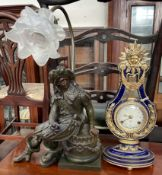 A Louis XV style clock with a sun surmount together with a Cavalier table lamp