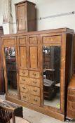 An Edwardian rosewood triple wardrobe,