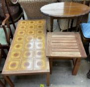 A tiled top coffee table together with an oak occasional table and a garden table