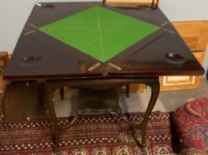 An Edwardian mahogany envelope card table,