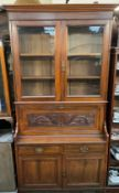 An Edwardian walnut bureau bookcase, with a moulded cornice above a pair of glazed doors,