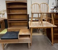 A kitchen table and two chairs together with a teak telephone table and a wall unit