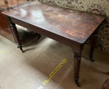A Victorian mahogany side table with a rectangular top on turned tapering legs and casters