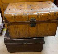 Two tin trunks