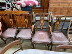 A set of four 19th century inlaid mahogany dining chairs with a pierced back,