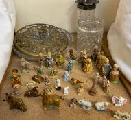 A collection of Wade pottery figures and animals together with glass vases etc
