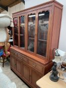A modern Chinese hardwood wall unit, with two pairs of glazed doors,