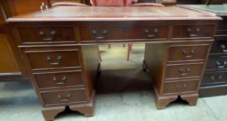 A reproduction yew pedestal desk,