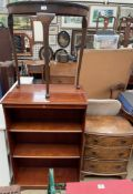 A pair of modern mahogany bookcases together with a side table and a walnut chest of drawers