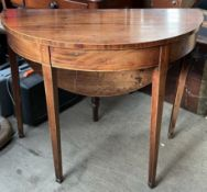 A 19th century mahogany side table with a hinged top and gateleg action on square tapering legs