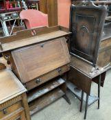 A 20th century oak bureau together with an oak gateleg table and a firescreen