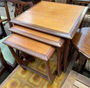A G-Plan Astro nest of three teak tables