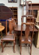 A set of four Queen Anne style dining chairs together with a rosewood effect drop leaf dining table