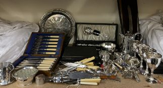 A collection of electroplated wares including goblets, spoons, carving set, cased fish set,