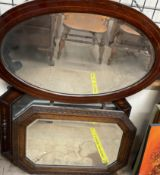 An oak cased wall mirror together with another oak framed wall mirror and a mahogany framed wall