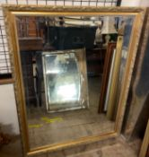 A large gilt framed wall mirror together with three other wall mirrors