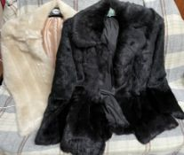 A black faux fur jacket together with another jacket