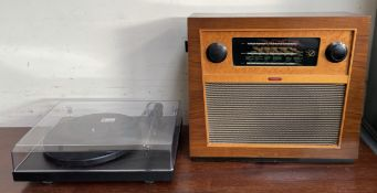 A Murphy walnut cased radio, with bakelite dials,