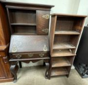 A late 19th century oak bureau bookcase on cabriole legs together with a pair of oak bookcases