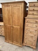 A large pine wardrobe together with a large pine chest of drawers and a pine bedside cabinet