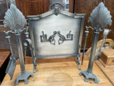 A white metal fire screen of pointed arch form,