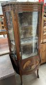 A French walnut and gilt metal mounted vitrine with a marble inset top with three quarter gallery