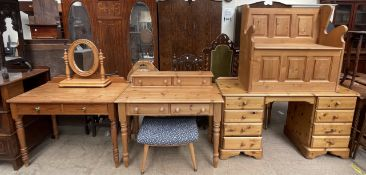 A pine box settle together with a pine desk, a pine side table, another pine desk,